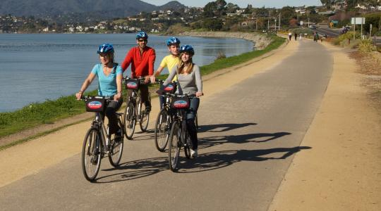 Family of four riding along the car free bike path to Tiburon