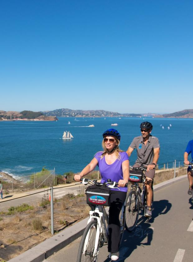 Bikers following the bike path to the Golden Gate Bridge on a beautiful sunny day