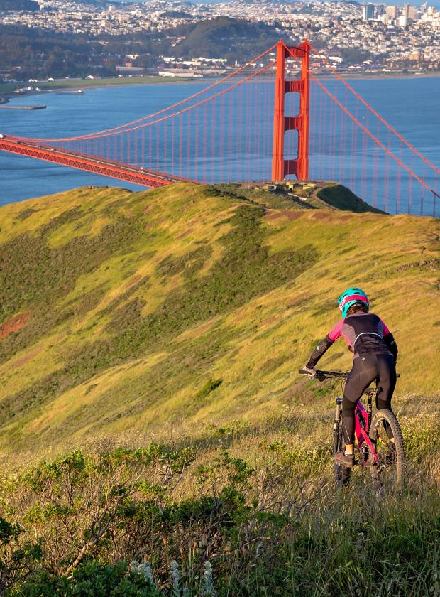 Riding a mountain bike off-road above the Golden Gate Bridge with amazing views!