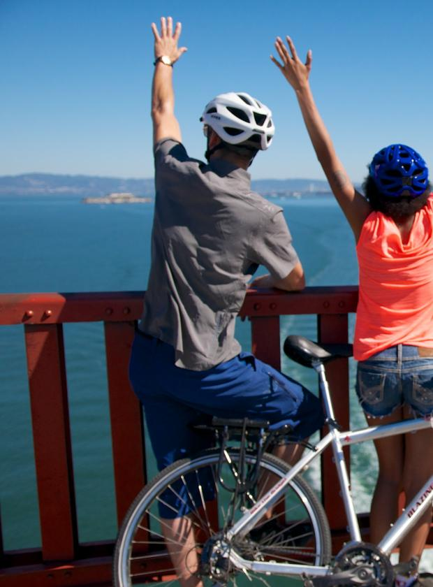 Celebrating biking across the Golden Gate Bridge and taking in the beautiful views of San Francisco and the Bay