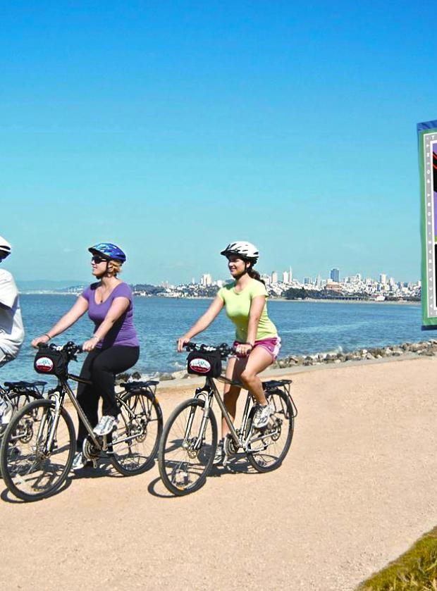 Group of bikers enjoing the majestic views along the National Park Bike Path along San Francisco's waterfront