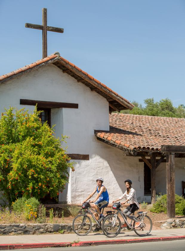 Biking in front of the Historic Mission San Francisco Solano in Sonoma County