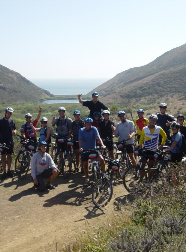 Mountain biking group posing at the end of an amazing ride in the picturesque Tennessee Valley