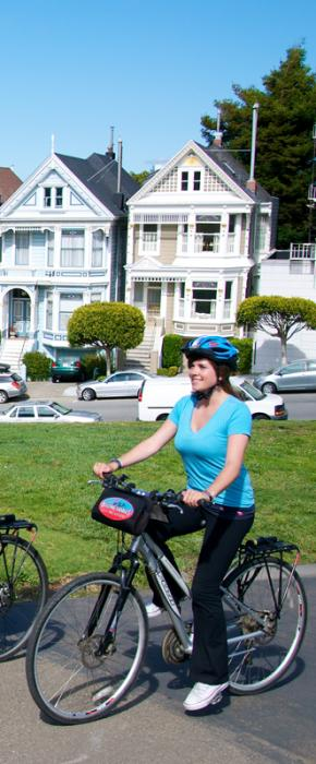 Bikers riding through Alamo Square enjoying the sight of the Painted Ladies from Full House