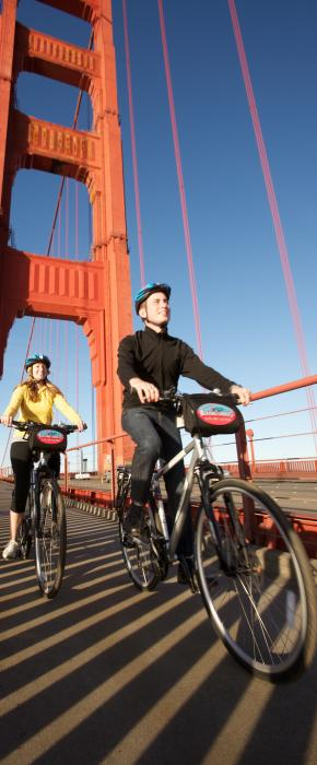 Couple riding across the Golden Gate Bridge on a beautiful clear day