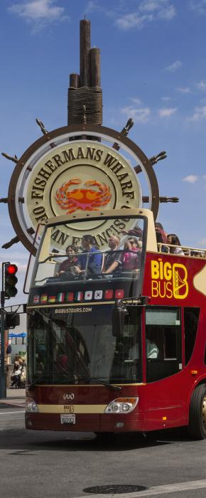 Big Bus open-top tour cruising along iconic Fisherman's Wharf in San Francisco